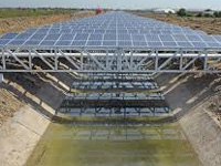 Solar panels atop irrigation canals to generate power