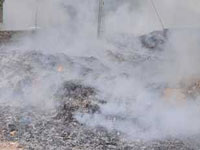 Fire halts garbage dumping